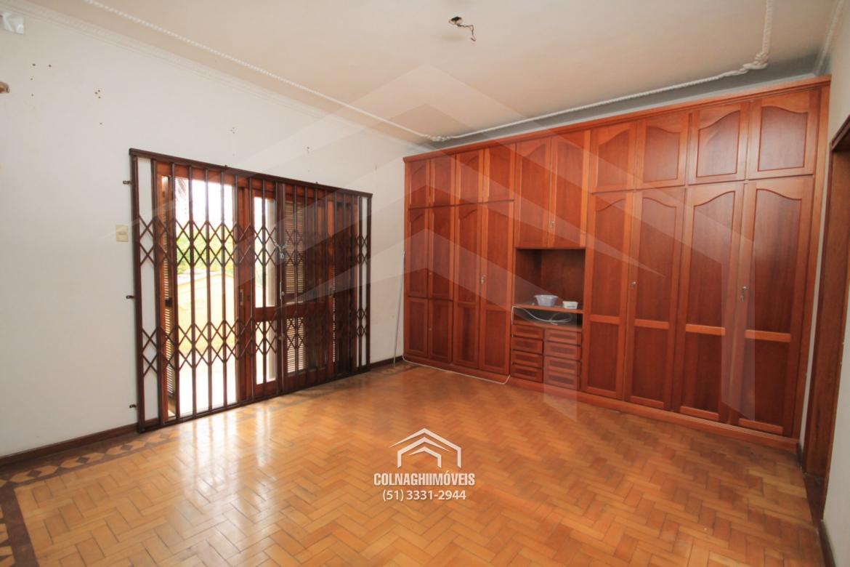Casa de 3 dormitórios à venda em Auxiliadora, Porto Alegre - RS