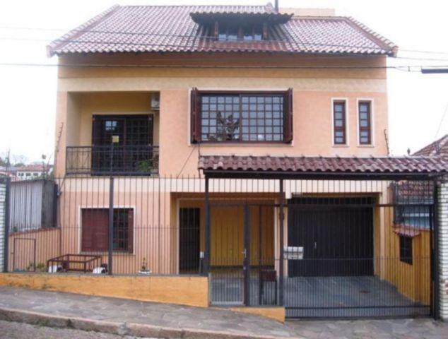Ducati Imóveis - Casa 4 Dorm, Porto Alegre (92118)