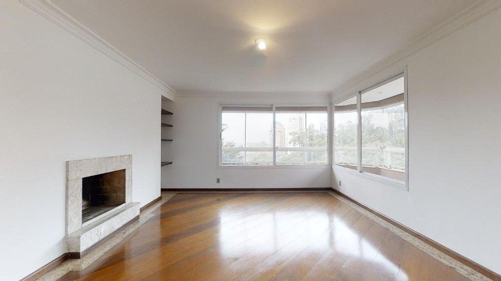 sala de estar com lareira voltada para terraço