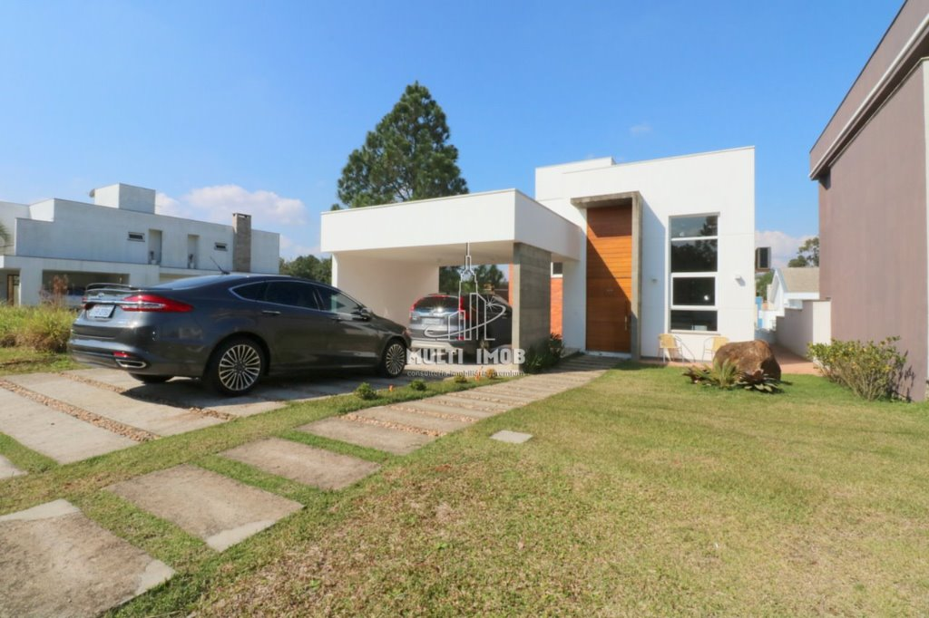 Casa em Condomínio  3 Dormitórios  1 Suíte  4 Vagas de Garagem Venda Bairro Jardim Krahe em Viamão RS