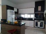 cozinha com abertura para área gourmet