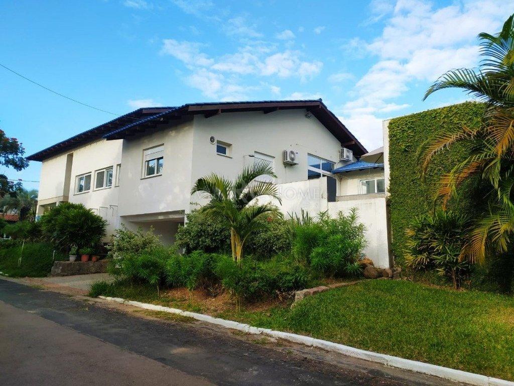 Casa em Condomínio  4 Dormitórios  2 Suítes  5 Vagas de Garagem Bairro Ipanema em Porto Alegre RS