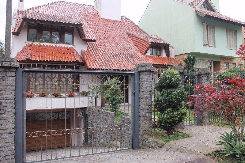 Casa  4 Dormitórios  2 Suítes  4 Vagas de Garagem Bairro Ipanema em Porto Alegre RS