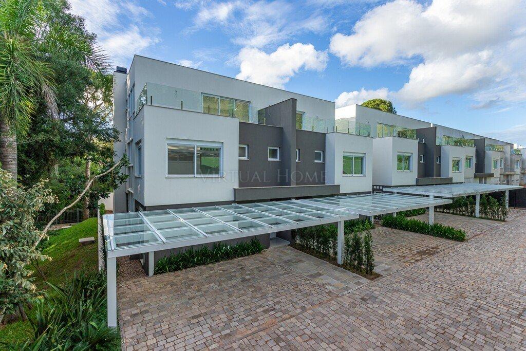 Casa em Condomínio  3 Dormitórios  3 Suítes  3 Vagas de Garagem Bairro Pedra Redonda em Porto Alegre RS