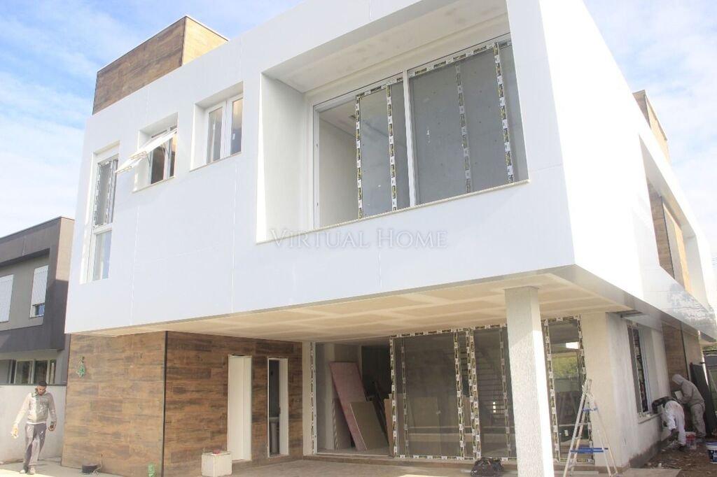 Casa em Condomínio  4 Dormitórios  4 Suítes  4 Vagas de Garagem Bairro Vila Nova em Porto Alegre RS